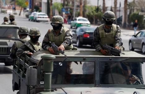 Soldiers patrol a main avenue in the border city of Ciudad Juarez